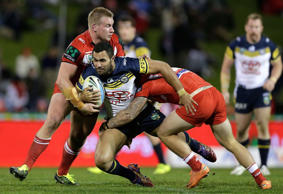 Justin O'Neill of the Cowboys is tackled during the round 17 NRL match between St George Illawarra Dragons and North Queensland Cowboys on July 4, 2015 in Australia.