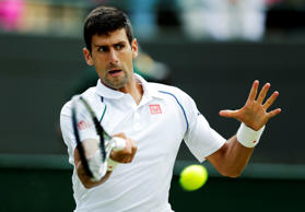 Novak Djokovic of Serbia hits a shot during his match against Kevin Anderson of South Africa at the Wimbledon Tennis Championships in London, July 7, 2015.