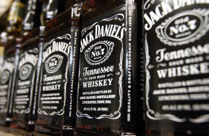 In this Dec. 5, 2011 photo, bottles of Jack Daniel's Tennessee Whiskey, line the shelves of a liquor outlet, in Montpelier, Vt. Liquor maker Brown-Forman Corp. reported a 2 percent gain in second-quarter profit Thursday, Dec. 8, 2011, on the strength of sales spikes for its flagship Jack Daniel's Tennessee Whiskey along with its vodka and tequila brands.
