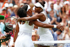 (From left) Serena Williams of the United States hugs her sister Venus Williams of the United States after their matchup during the Wimbledon Tennis Championships on July 6, 2015, in London. Serena won 6-4, 6-3.