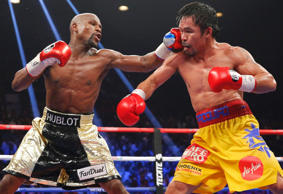 File photo of Mayweather, Jr. landing a left to the face of Pacquiao in the 11th round during their welterweight title fight in Las Vegas