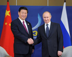 File: Chinese President Xi Jinping (L) meets with Russian President Vladimir Putin in Bali, Indonesia, Oct. 7, 2013.