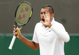 Nick Kyrgios of Australia reacts during his match against Richard Gasquet of France at the Wimbledon Tennis Championships in London, July 6, 2015.