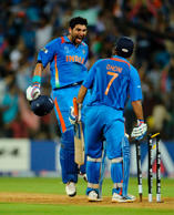 India's Yuvraj Singh (facing camera) races to captain Mahendra Singh Dhoni after India won the ICC Cricket World Cup final match against Sri Lanka in Mumbai April 2, 2011.