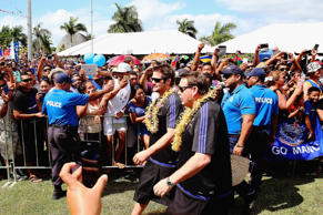 Richie McCaw and head coach Steve Hansen of the New Zealand All Blacks are welcomed by fans on July 7, 2015 in Apia, Samoa.