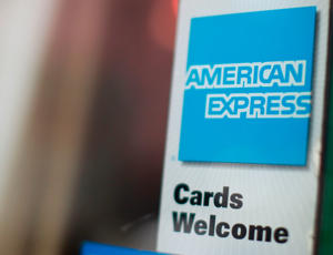 An American Express sign is seen on a door.