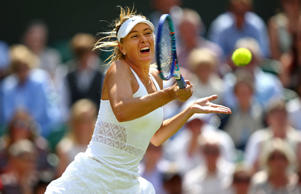 Maria Sharapova of Russia plays a forehand in her Ladies Singles Quarter Final match against Coco Vandeweghe of the United States during day eight of the Wimbledon Lawn Tennis Championships at the All England Lawn Tennis and Croquet Club on July 7, 2015 in London, England.