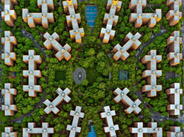 Stuyvesant FULL COPY: http://www.rexfeatures.com/nanolink/qm91  A photographer has taken stunning aerial images of New York for an exhibition.  Jeffrey Milstein is known for taking a God's-eye view of cities and residential areas with high-resolution camera equipment from the open door of a helicopter.  He has now released these photographs of the Big Apple as part of a two new solo shows opening this week titled LANY, running concurrent in NYC and LA.  A highlight in this series is a fascinating sky-high look at the ordered cluster of brown buildings that comprise Stuyvesant Town, a residential development in New York City.  There are also aerial views of the Statue of Liberty, the Metropolitan Museum, Times Square at night and the Empire State Building.  (Jeffrey's previously-released Los Angeles images can be seen here: http://www.rexfeatures.com/nanolink/qm8s)