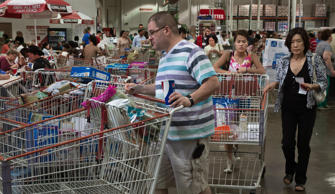 Shoppers at the COSTCO store in Fairfax, Virginia leave the crowed check-out with carts.