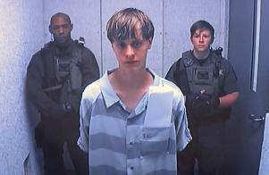 Dylann Roof appears via video before a judge, in Charleston, S.C., Friday, June 19, 2015. The 21-year-old accused of killing nine people inside a black church in Charleston made his first court appearance, with the relatives of all the victims making tearful statements.