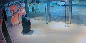 This image made from video released by the Abu Dhabi police department on Tuesday, Dec. 2, 2014 shows a veiled suspect in the stabbing of an American teacher in a shopping mall restroom as seen on security camera footage in Abu Dhabi, United Arab Emirates.