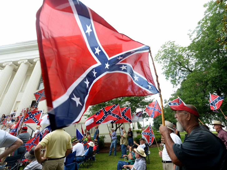 Supporters gather for a rally to protest the removal of Confederate flags from the Confederate Memorial Saturday on June 27 in Montgomery, Ala.
