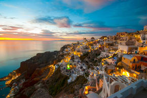 Arrive early to the village of Oia to watch the sun set into the azure Aegean Sea. Crowds gather around the crumbling castle on the town's highest point and in the streets to watch the fiery orange-red burst meet the blue sea.