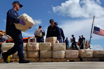 FILE - Crewmembers from the Coast Guard Cutter Northland offload cocaine confiscated in Miami Beach, Florida. Joe Raedle/Getty Images