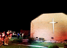 Firefighters work at the scene of a fire at Mount Zion African Methodist Episcopal church in Greeleyville, S.C., Tuesday, June 30, 2015. The African-American church that was burned down by the Ku Klux Klan in 1995 caught fire again Tuesday night.