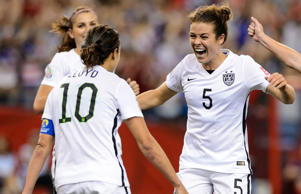 Kelley O'Hara #5 of the United States celebrates with teammates after scoring a goal in the second half against Germany in the FIFA Women's World Cup 2015 Semi-Final Match at Olympic Stadium on June 30, 2015 in Montreal, Canada.
