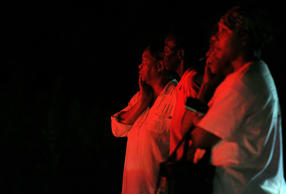 Bystanders watch as public safety personnel work at the scene of a fire at Mount Zion African Methodist Episcopal church, late Tuesday night, June 30, 2015, in Greeleyville, S.C.