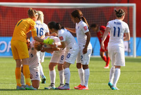Laura Bassett of England is comforted by team mates after the FIFA Women's World Cup Semi Final match