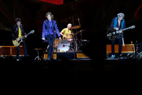 Mick Jagger, in blue, performs with Keith Richards, right, Ronnie Wood, left, and Charlie Watts on drums as The Rolling Stones play in Pittsburgh.