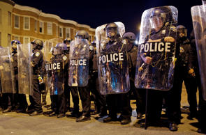 Police stand in formation as a curfew approaches, Tuesday, April 28, 2015, in Baltimore, a day after unrest that occurred following Freddie Gray's funeral. Patrick Semansky/AP