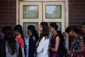 File: Indian girls queue to buy college admission forms at the Delhi University Arts Faculty as admissions to Delhi University's four-year undergraduate programme has  opened in New Delhi, India, Monday, June 2, 2014.