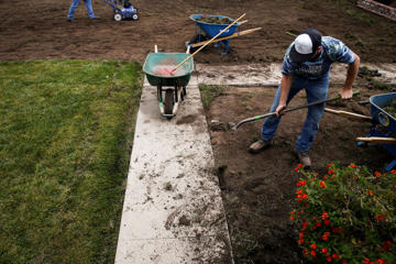 Landscapers with Turf Terminators remove the front grass lawn of a home to replace it with drought-friendly landscaping in Chatsworth, California on Tuesday, April 21, 2015. As California's water shortage grows more severe and local governments enact increasingly stringent conservation policies, homeowners across the state are reimagining their lawns.