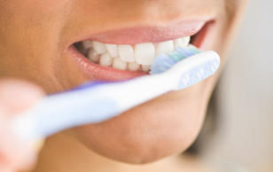 A woman brushing her teeth. Representative photo.
