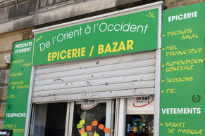 This picture taken on June 22, 2015 shows a Muslim-owned grocery store in the neighbourhood of Saint-Michel in Bordeaux. The shop has sparked controversy by having affixed to its window a placard indicating separate opening days for men and women, a decision that was judged illegal and discriminating by local authorities.