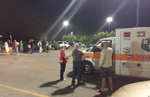 Emergency personnel stand by as evacuees gather at the Foothills Mall early Thursday, July 2, 2015, in Maryville, Tenn., after they were forced to leave their homes when rail car carrying a flammable and toxic gas has derailed and caught fire.