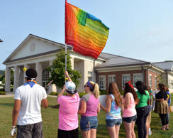 Protesters waive a rainbow flag on the front lawn of the Rowan County Judicial Center, Tuesday, June 30, 2015, in Morehead, Ky. The protest was being held against Rowan County Clerk Kim Davis, who, due to the ruling of the Supreme Court of the United States and her own religious beliefs, has refused to issue any marriage licenses in the county.