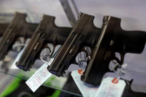 Handguns are seen for sale in a display case at Metro Shooting Supplies in Bridgeton, Missouri on November 13, 2014.