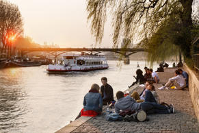 People relaxing on the River Seine in Paris.