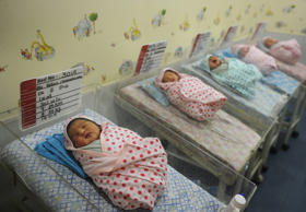 Newly born babies sleep inside a private hospital in Kolkata, India on October 31, 2011.