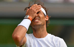 Spain's Rafael Nadal reacts after a point against Germany's Dustin Brown during their men's singles second round match on day four of the 2015 Wimbledon Championships at The All England Tennis Club in Wimbledon, southwest London, on July 2, 2015.