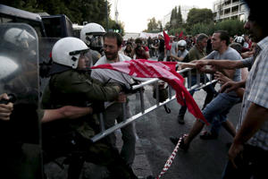 Anti-Euro protesters scuffle with riot police at the European Union Representation offices in Athens, Greece, on Thursday.