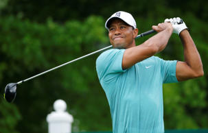 Tiger Woods watches his tee shot on the 12th tee during the first round of the Greenbrier Classic golf tournament at the Greenbrier Resort  in White Sulphur Springs, W.Va., on Thursday.