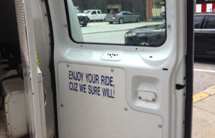 A sign posted inside a Baltimore police van. WBAL TV