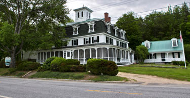 This June 5, 2015, file photo shows the Center Lovell Inn in Lovell, Maine. Maine State Police said Monday, June 22, 2015, they are investigating whether an innkeeper violated state law in an essay contest with her 210-year-old country inn as the prize. Robert F. Bukaty/AP