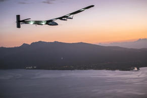 In this photo provided by Jean Revillard, Solar Impulse 2, a plane powered by the sun's rays and piloted by Andre Borschberg, approaches Kalaeloa Airport near Honolulu, Friday, July 3, 2015.