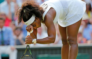Serena Williams of the U.S.A. reacts during her match against Heather Watson of Britain at the Wimbledon Tennis Championships in London, July 3, 2015.