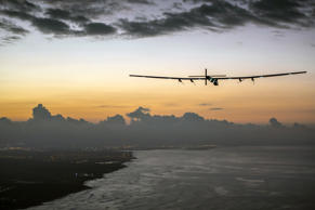 Solar Impulse 2, a plane powered by the sun's rays and piloted by Andre Borschberg, approaches Kalaeloa Airport near Honolulu, Friday, July 3, 2015. Jean Revillard/SI2/AP