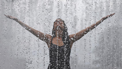 Thirty-year-old Maria, from Spain, enjoys the refreshment of the fountain in Southbank, London, Wednesday, July 1, 2015. Britain is preparing itself for the hottest day in nine years Wednesday, with temperatures possibly rising to 35 Celsius (95 Fahrenheit) in London. Frank Augstein/AP