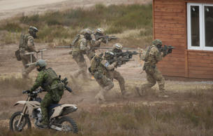 Special Forces of the Polish Army atttack a house during the NATO Noble Jump military exercises of the VJTF forces on June 18, 2015 in Zagan, Poland.