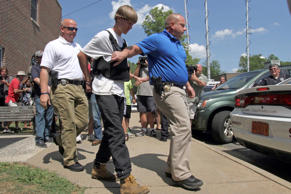 Charleston, S.C., shooting suspect Dylann Storm Roof is escorted from the Sheby Police Department in Shelby, N.C. Ben Earp/AP