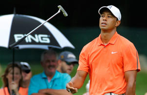 Tiger Woods flips his putter after missing a birdie on the fourth hole during the third round of the Greenbrier Classic golf tournament at the Greenbrier Resort in White Sulphur Springs, W.Va., Saturday, July 4, 2015. Rain caused delays in play.