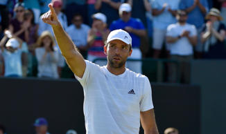 Ivo Karlovic of Croatia celebrates after winning his match against Jo-Wilfried Tsonga of France.