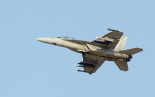 File: An F18 Super Hornet fighter jet flies during the Dubai Airshow November 18, 2013.