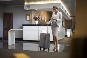 Businesswoman in hotel lobby. Digital Vision/Getty Images