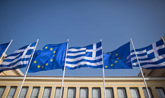 The national flag of Greece and the flag of the European Unio