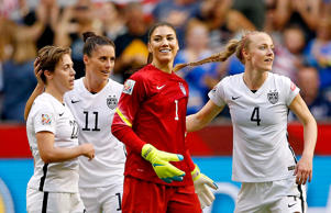 United States goalkeeper Hope Solo (1) and defender Becky Sauerbrunn (4) and defender Meghan Klingenberg (22) and defender Ali Krieger (11) celebrate their win over Nigeria in a Group D soccer match June 16 in Vancouver, British Columbia.